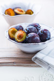Fresh plums on a kitchen table