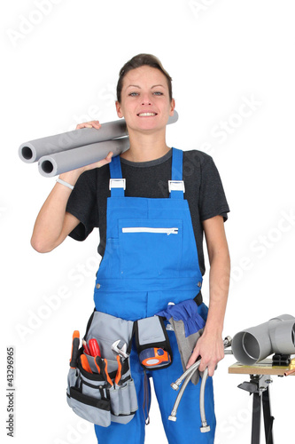 Female labourer stood by tools and equipment