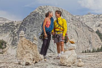 Loving climbing couple on the summit.