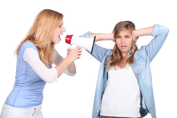 Girls screaming in a bullhorn and girl covering her ears