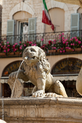 Lion fountain in the main town square of Assisi, Italy