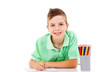 Beautiful little boy drawing with colorful crayons, isolated ove
