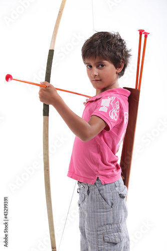 A little boy with a bow and arrow.