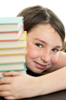 School girl hiding behind stack of books
