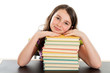 School girl resting head on stack of books