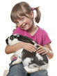happy little girl playing with her rabbit