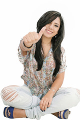 Closeup portrait of a beautiful young woman showing thumbs up si