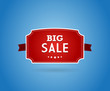 Red board with big sale sign.