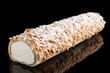 Swiss roll of whipped cream and almonds