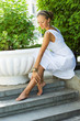 Greek styled girl caressing her legs