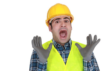 Construction worker letting out a cry of horror