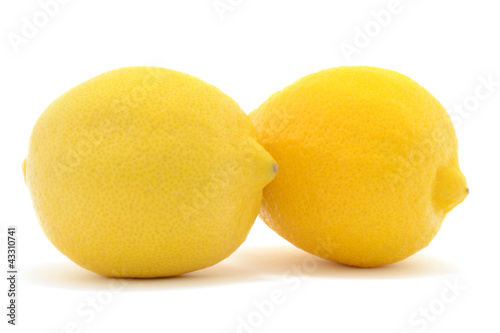 Two yellow lemons isolated over white