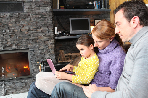 Family on a sofa in front of the fireplace