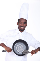 Cook holding pan with email symbol