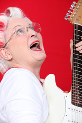 Old woman with curlers and guitar