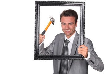 Agressive businessman with picture frame