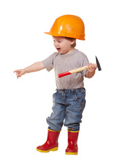 Toddler in hardhat with hammer. Isolated over white