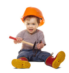 Toddler in hardhat with tools. Isolated over white
