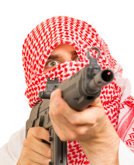 Arab adult with a machine gun, terrorist