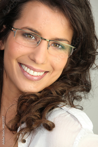 Pretty brunette wearing glasses