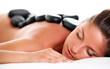 Woman enjoying a hot stone massage
