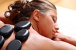 Woman enjoying a hot stone massage