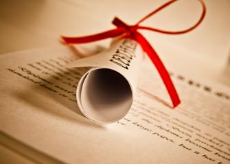 Diploma with red ribbon