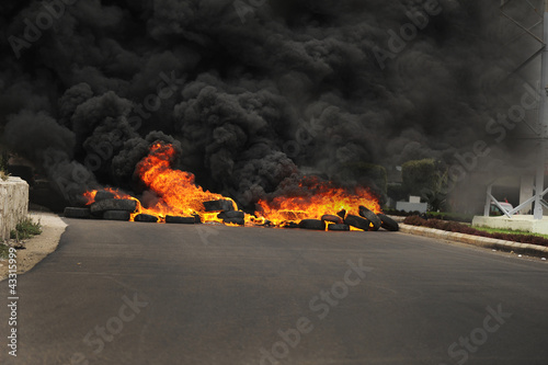 Burning tires during a protest causing poisoning smoke