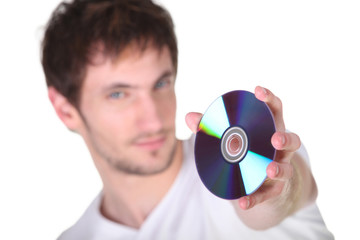 Young man showing CD, studio shot