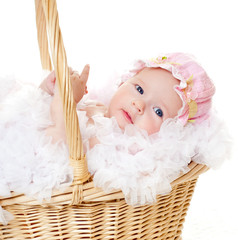 baby in a wicker basket