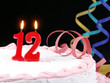 Birthday cake with red candles showing Nr. 12