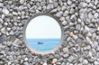 hole  on the rock wall  with ocean background