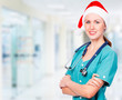 Smiling doctor wearing red Santa hat