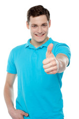Handsome casual smiling guy showing thumbs up