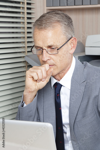 focus businessman reads messages on the computer