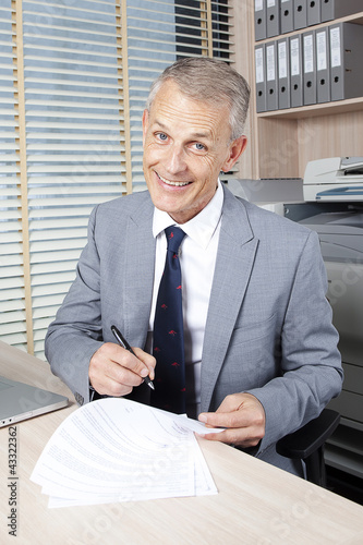 happy businessman sign a contract