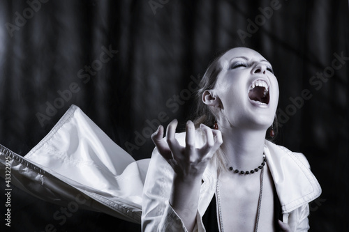 young woman screaming  - vampire style