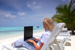 tropical business woman with laptop