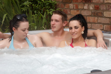 People relaxing in a jacuzzi