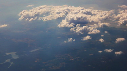 White puffy clouds seen from an airplane