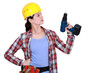 Tradeswoman holding an electric screwdriver