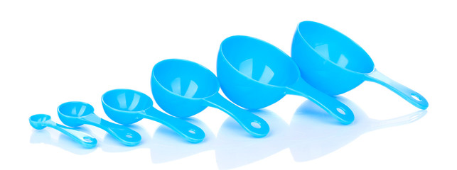 Blue measuring spoons isolated on white