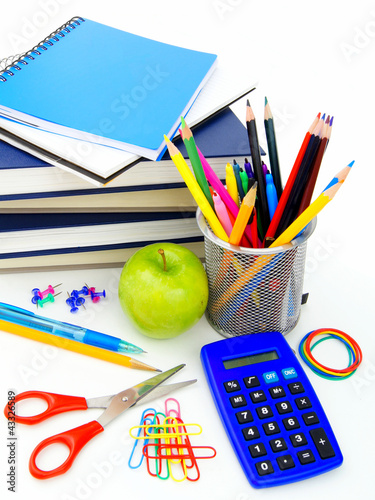 Group of school supplies and items over a white background