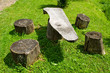 Table and chairs of wood trunk stumps. Rest place
