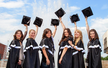Graduates in robes near the fountain