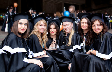 A group of girls in gowns of graduates