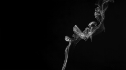 Plumes of white smoke in super slow motion rising