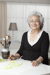 Senior Asian woman practicing calligraphy