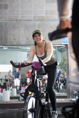 People on exercise bikes in health club