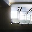 Caucasian businessman using laptop on office ledge